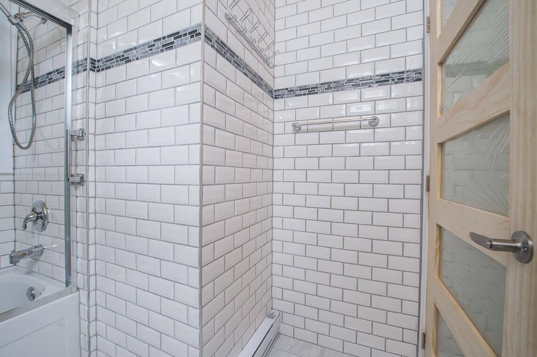 Kitchen Renovation Mackly Project White ceramic backsplash Glass shower doors White bathroom