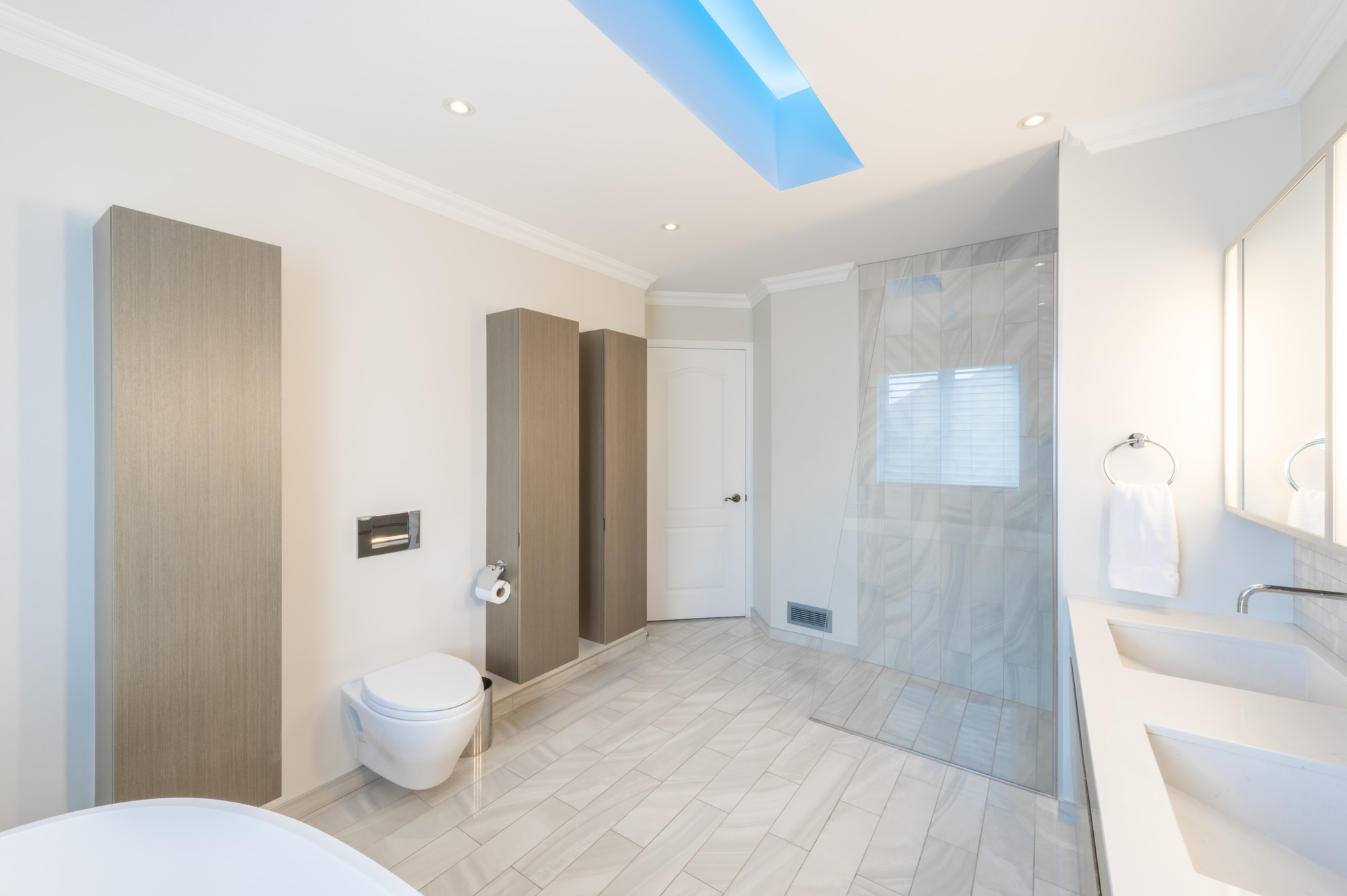 modern bathroom with glass shower and built-in cabinets
