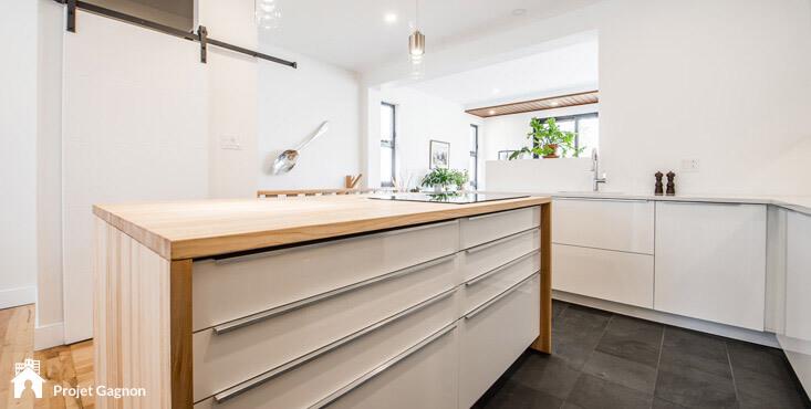 Modern kitche wooden kitchen island quartz countertops dark ceramic floor tiles