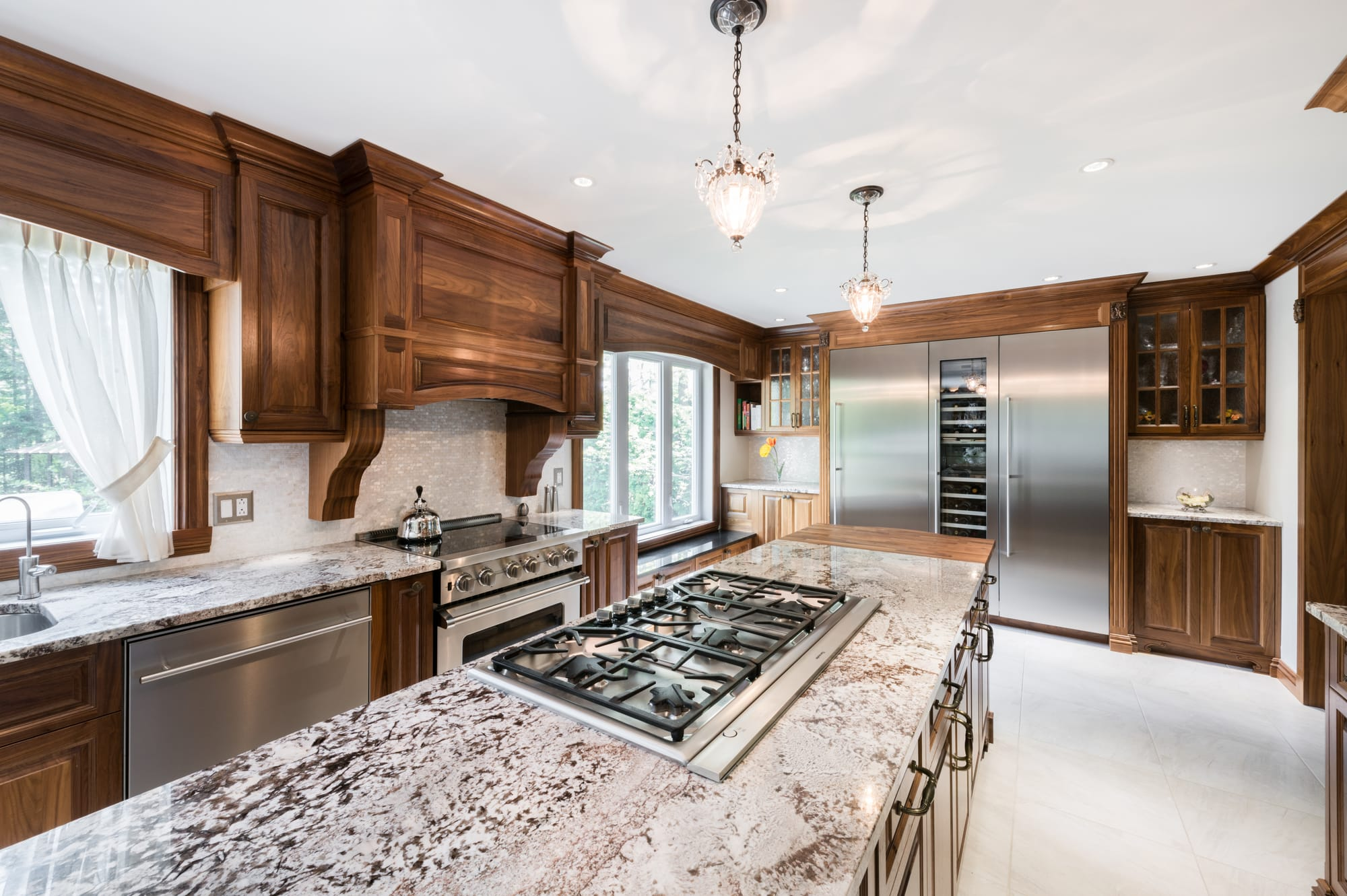 classic kitchen remodel with a big island and granit countertops
