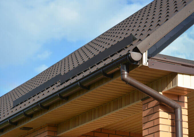 brown roof with gutters