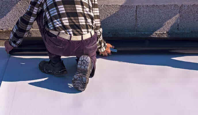 Man installing a TPO roof