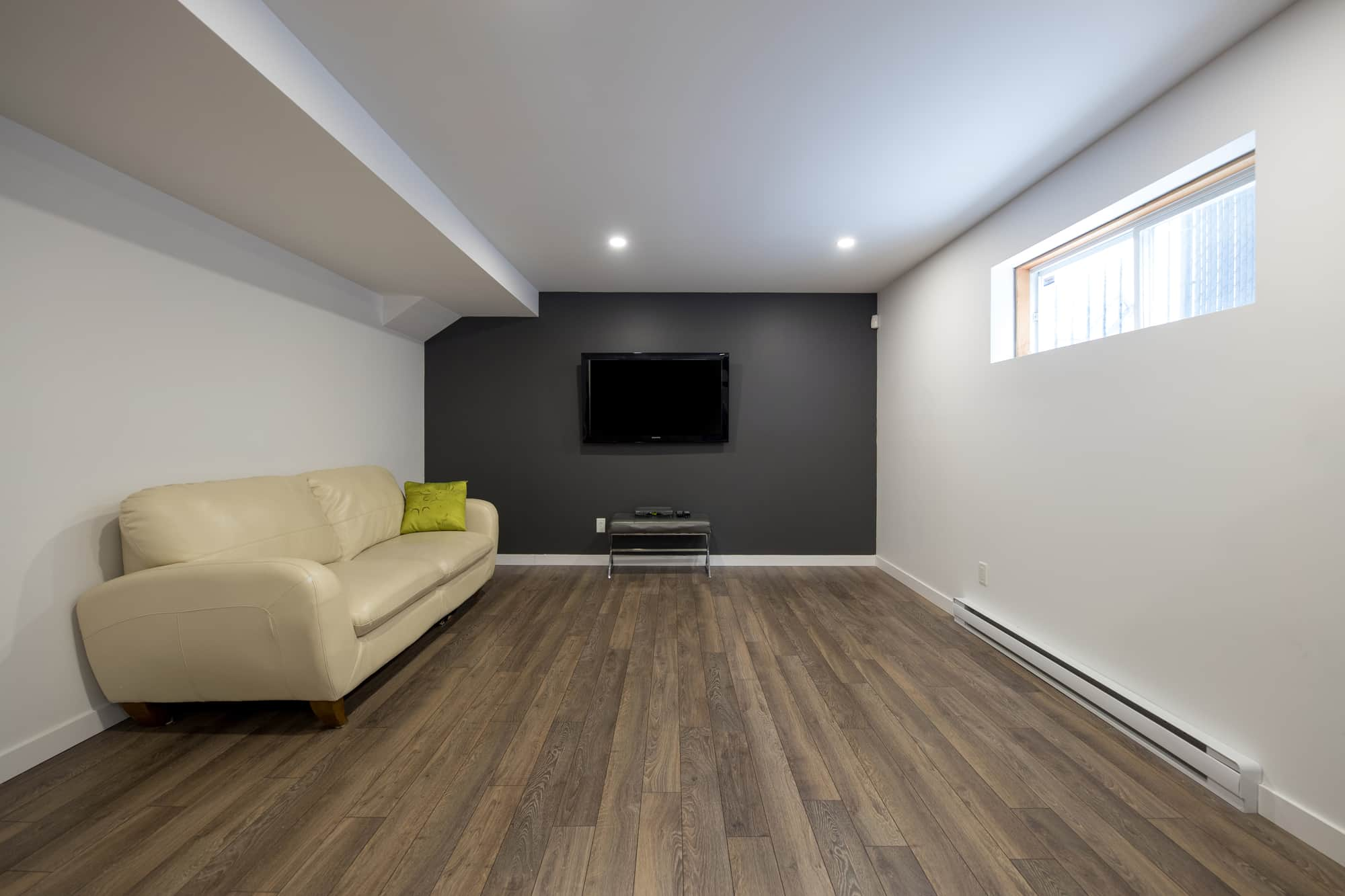 Basement renovation with floating wooden floor