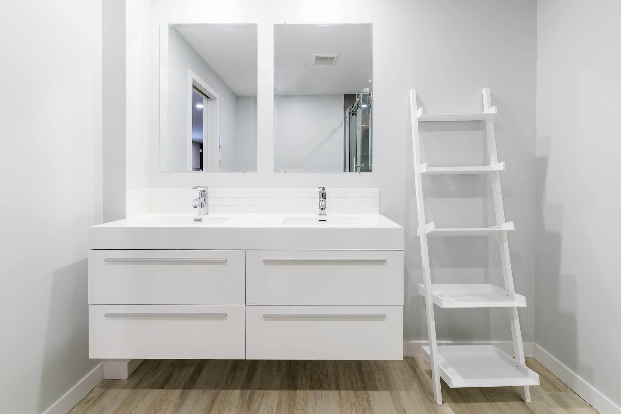 White bathroom vanity in a basement