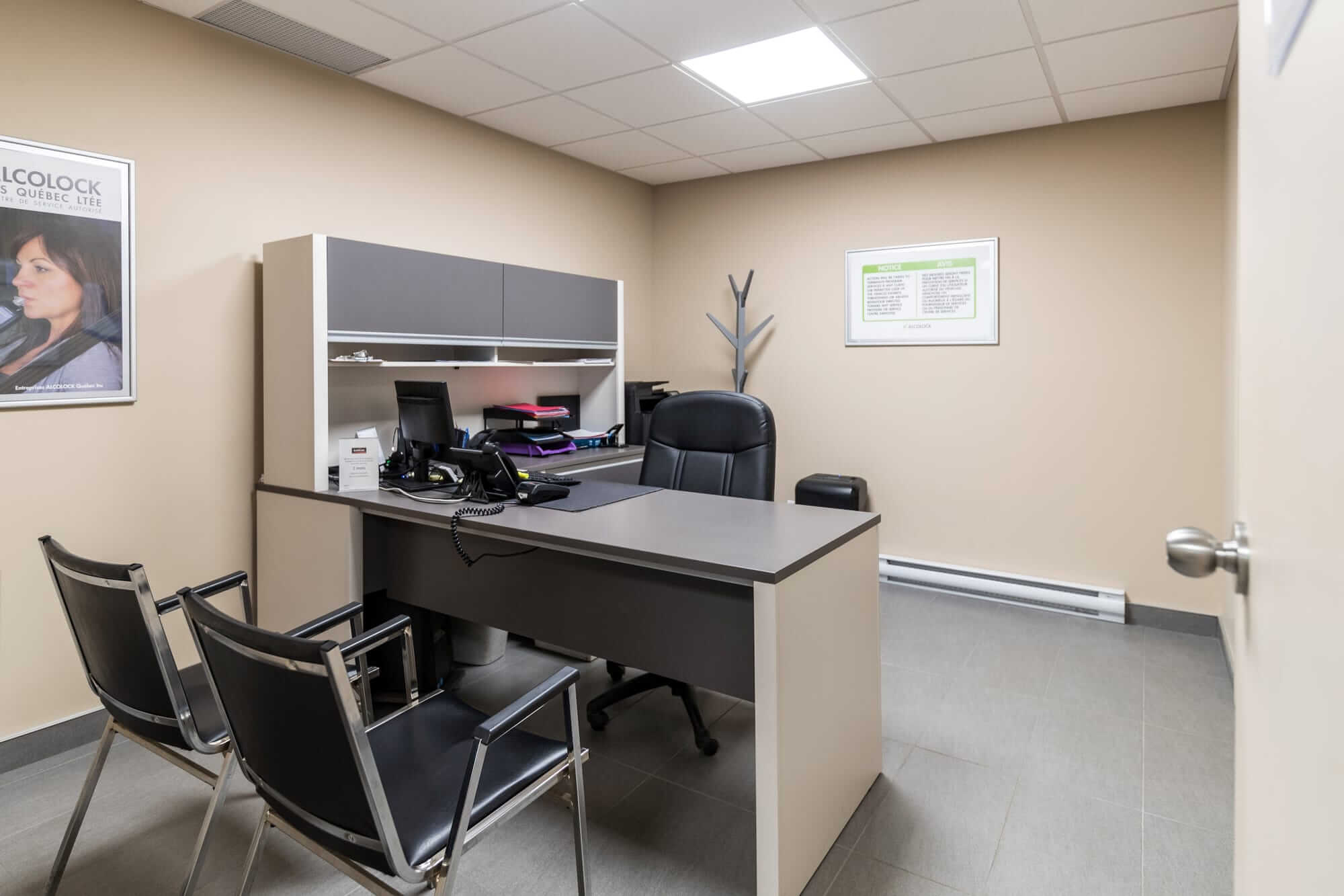 office renovation with beige desk and black chairs