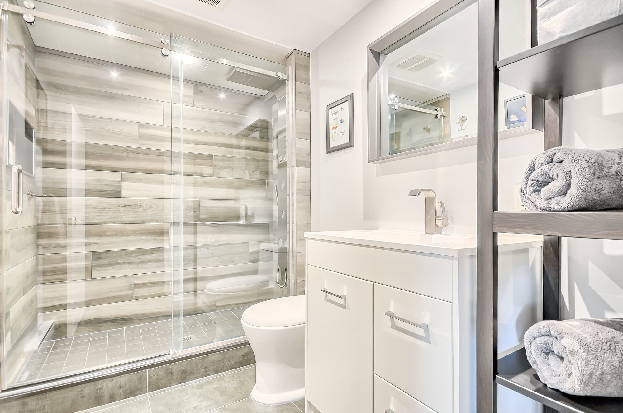 modern bathroom remodel with a white vanity