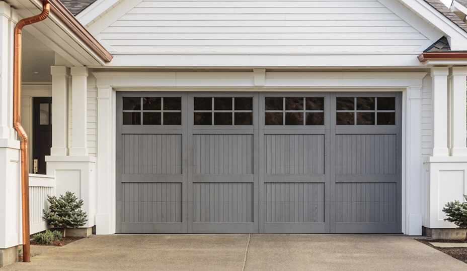 white house with grey garage door