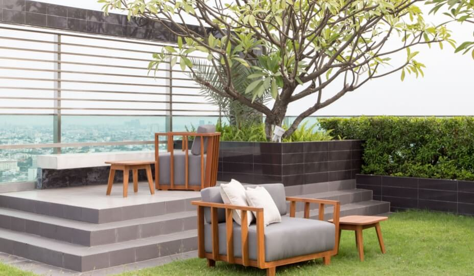 rooftop patio with tree and furniture