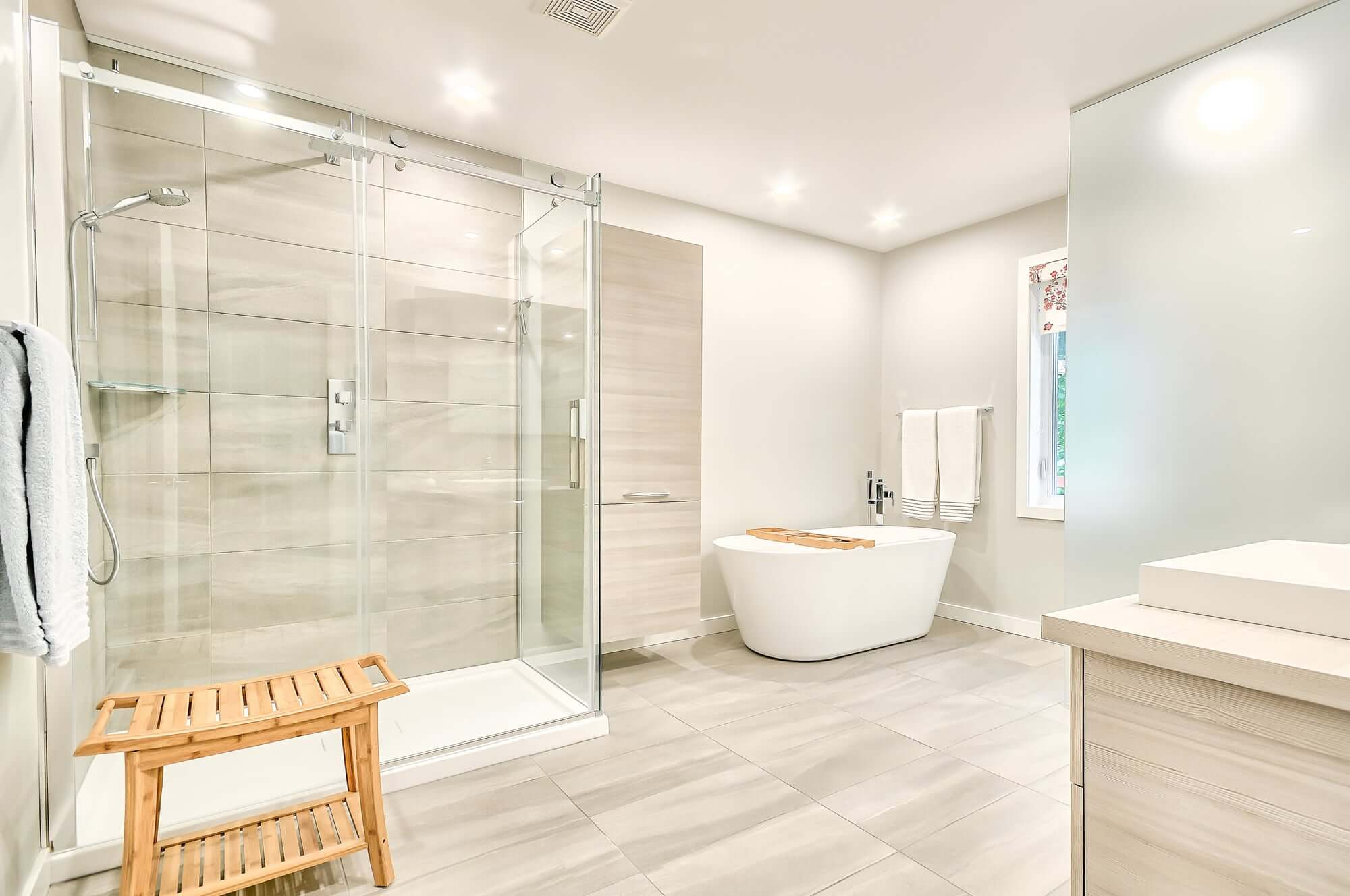 contemporary bathroom with glass shower and free standing tub