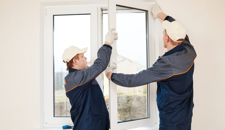 two men replacing a pvc window