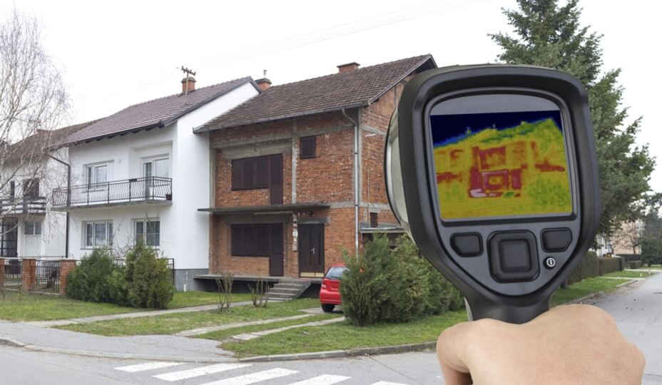 thermal imaging gun pointed at a house