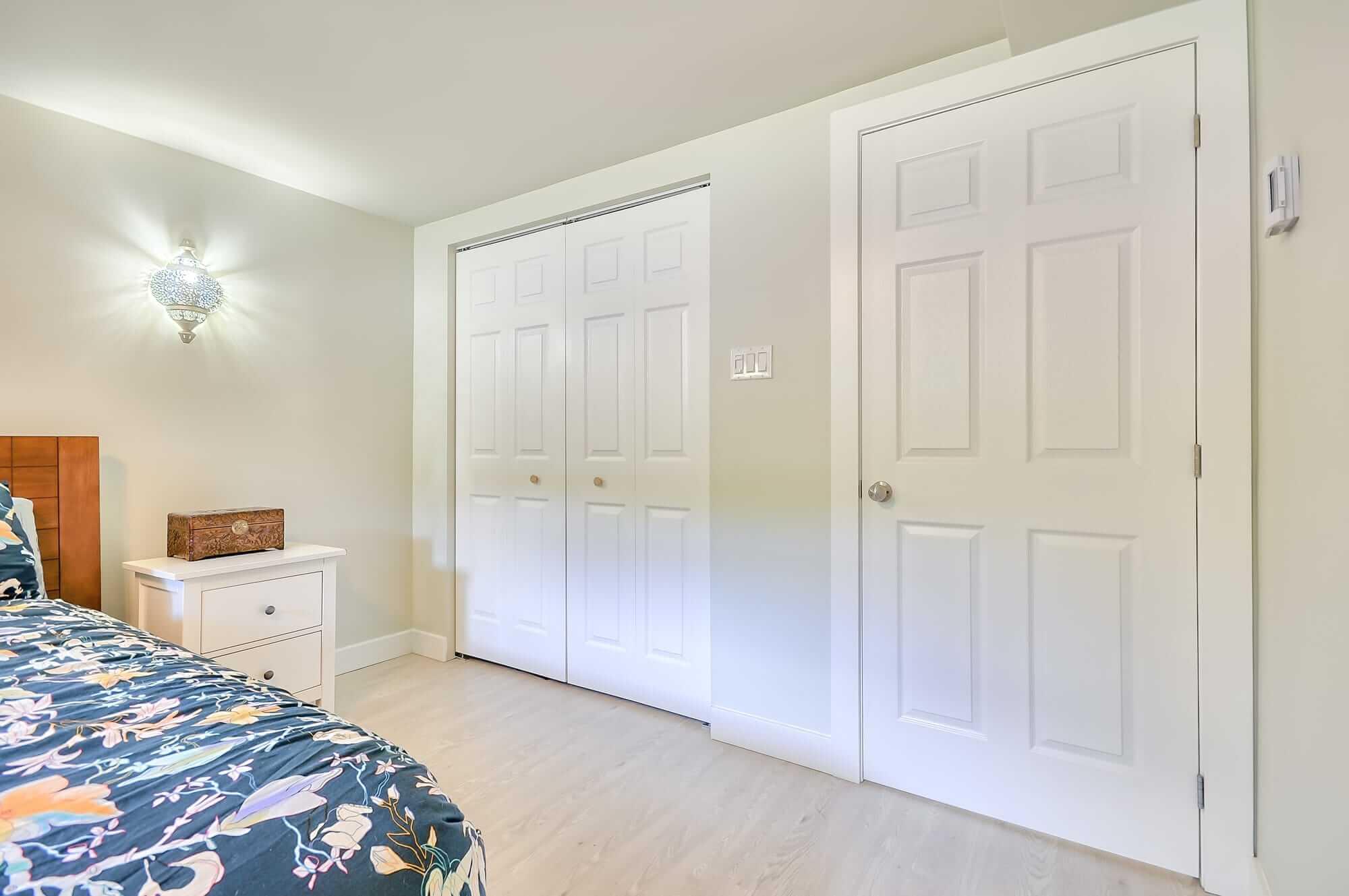 white doors in a basement bedroom