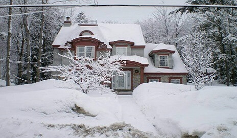 two-storey home covered in snow