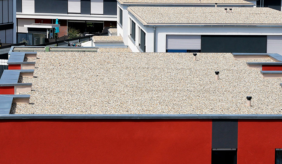 gravel rooftop on red building