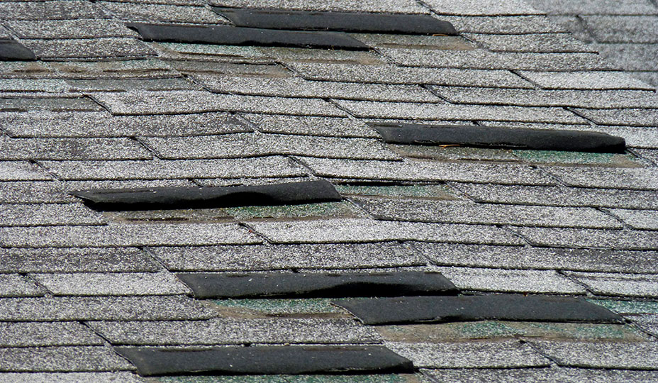 old roof with deterioring shingles