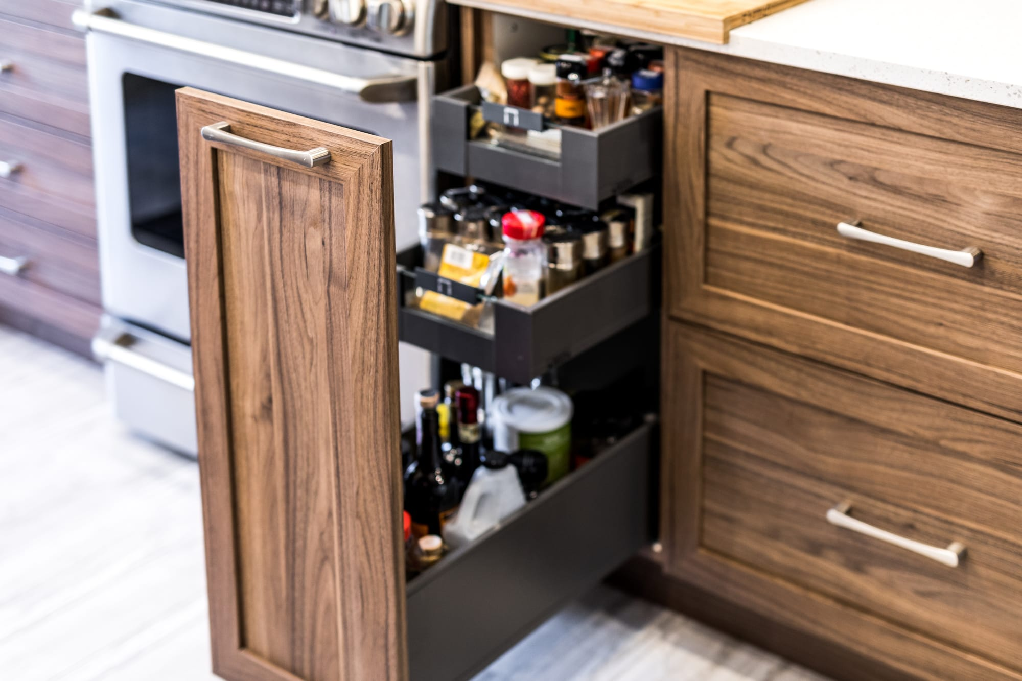 spices drawer in a newly renovated kitchen with brown cabinets