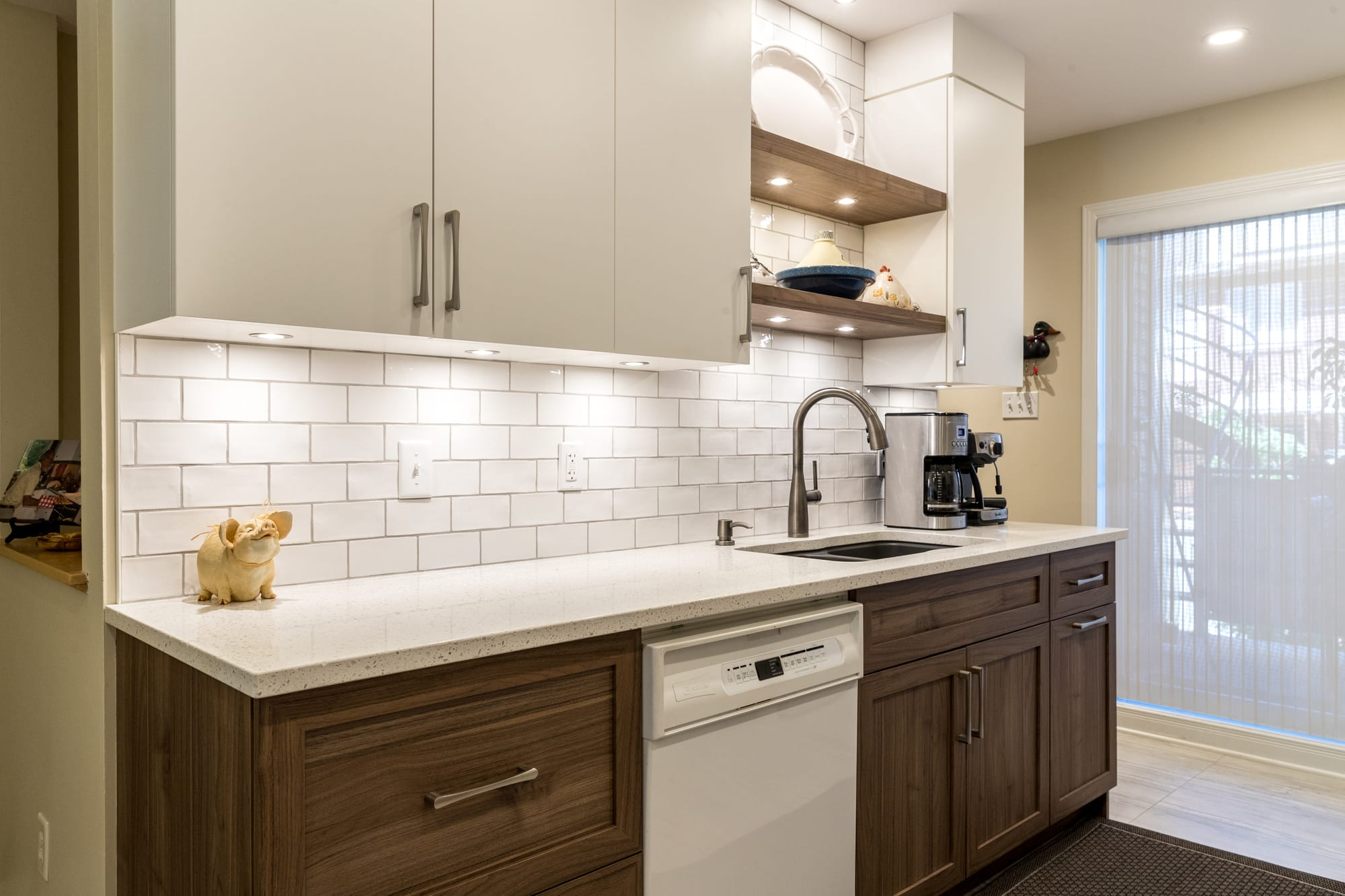 two tone kitchen with a quartz countertop