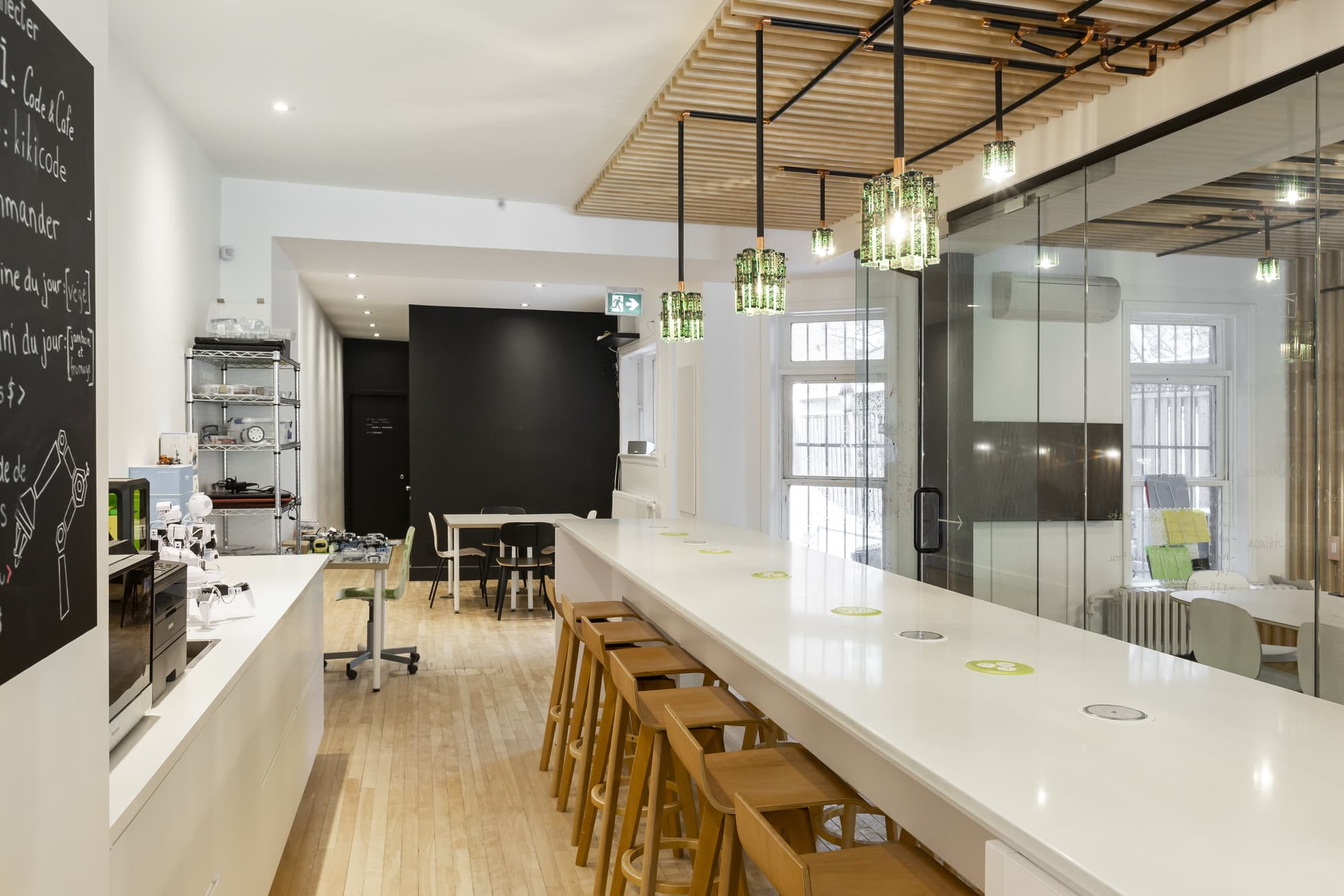 cafe renovation with white counters and black menu board