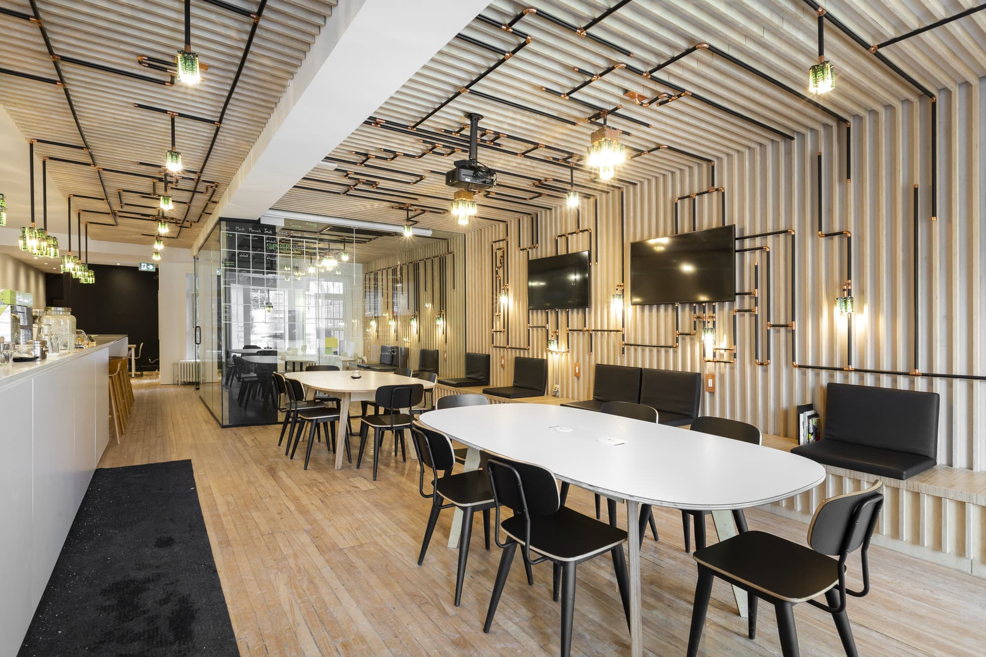 commercial design - internet cafe with beige tables and black chairs