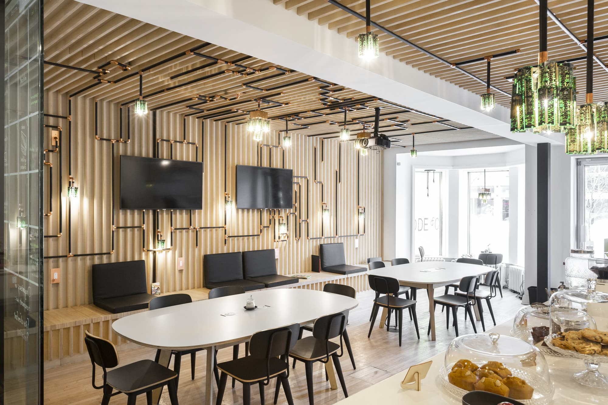 design commercial - coffee shop with white tables, black chairs and televisions