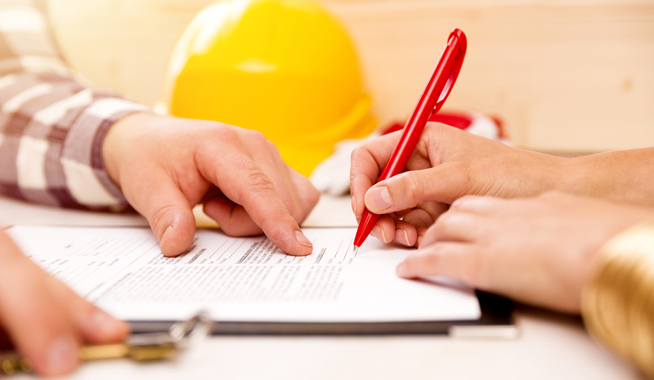 woman signing contract with contractor