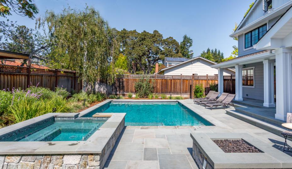 backyard with pool and hot tub
