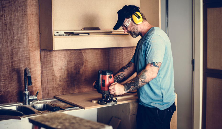 contractor sanding a cabinet