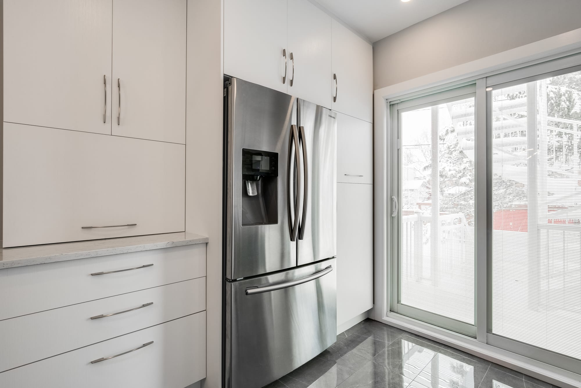 kitchen ideas - white cabinets and stainless steel refrigeretor