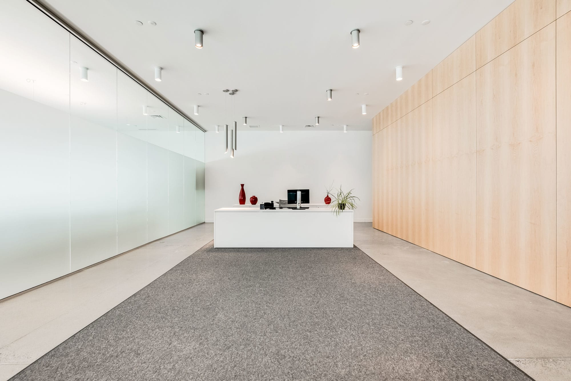 white reception desk in a newly renovated office