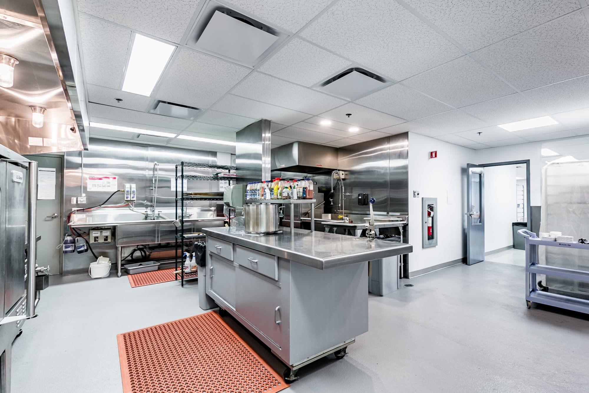 commercial kitchen renovation with stainless steel equipment