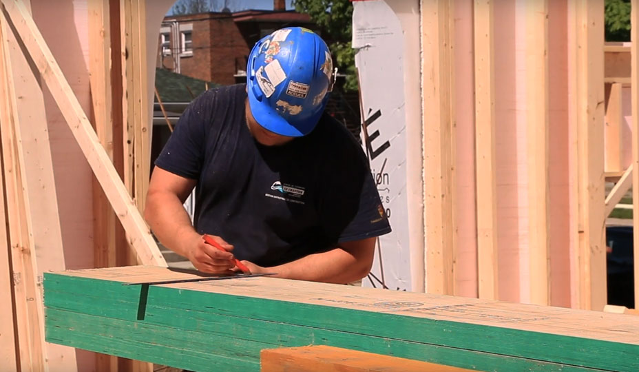 construction-worker-building-a-home-addition-frame