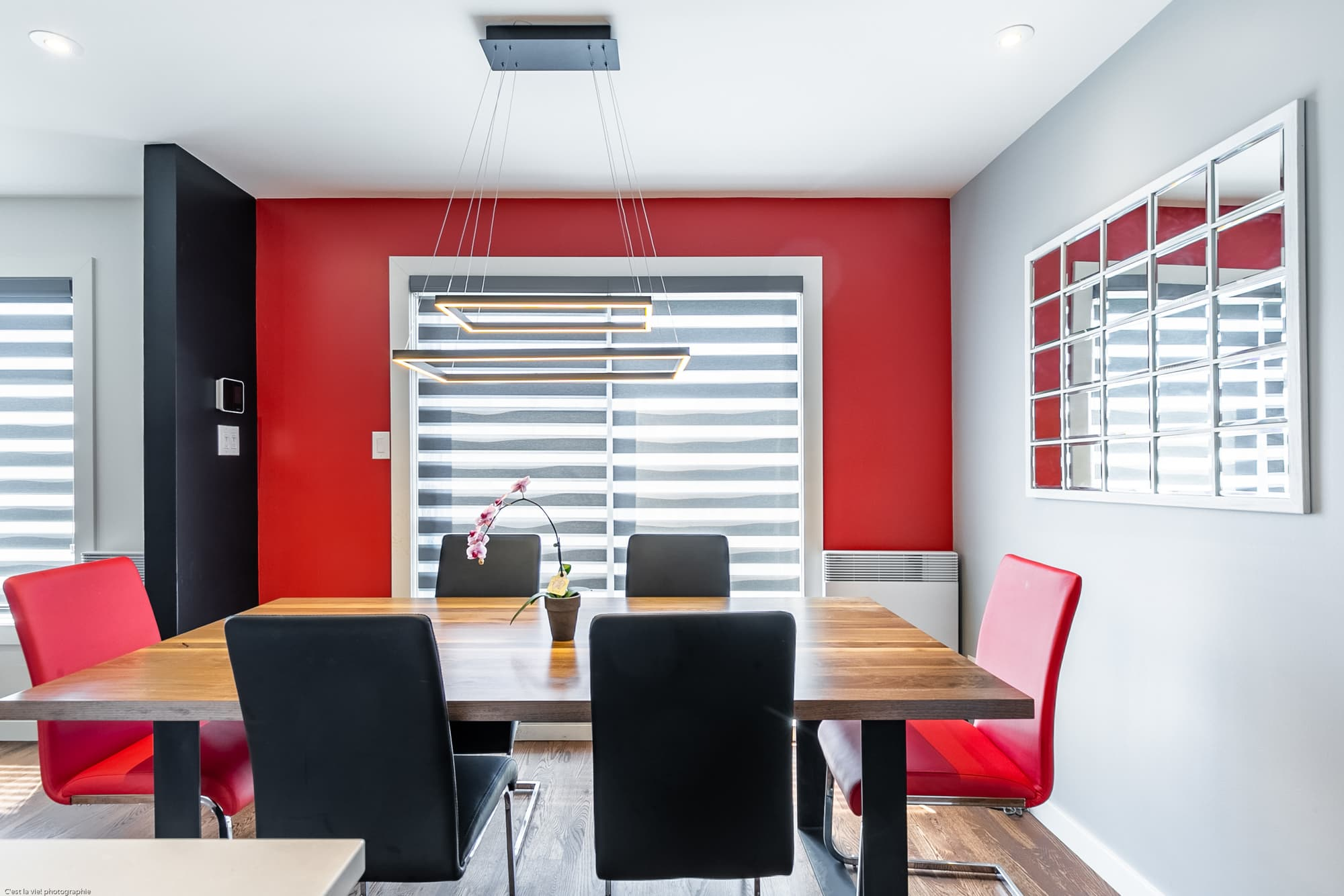 newly renovated dining room with a red wall