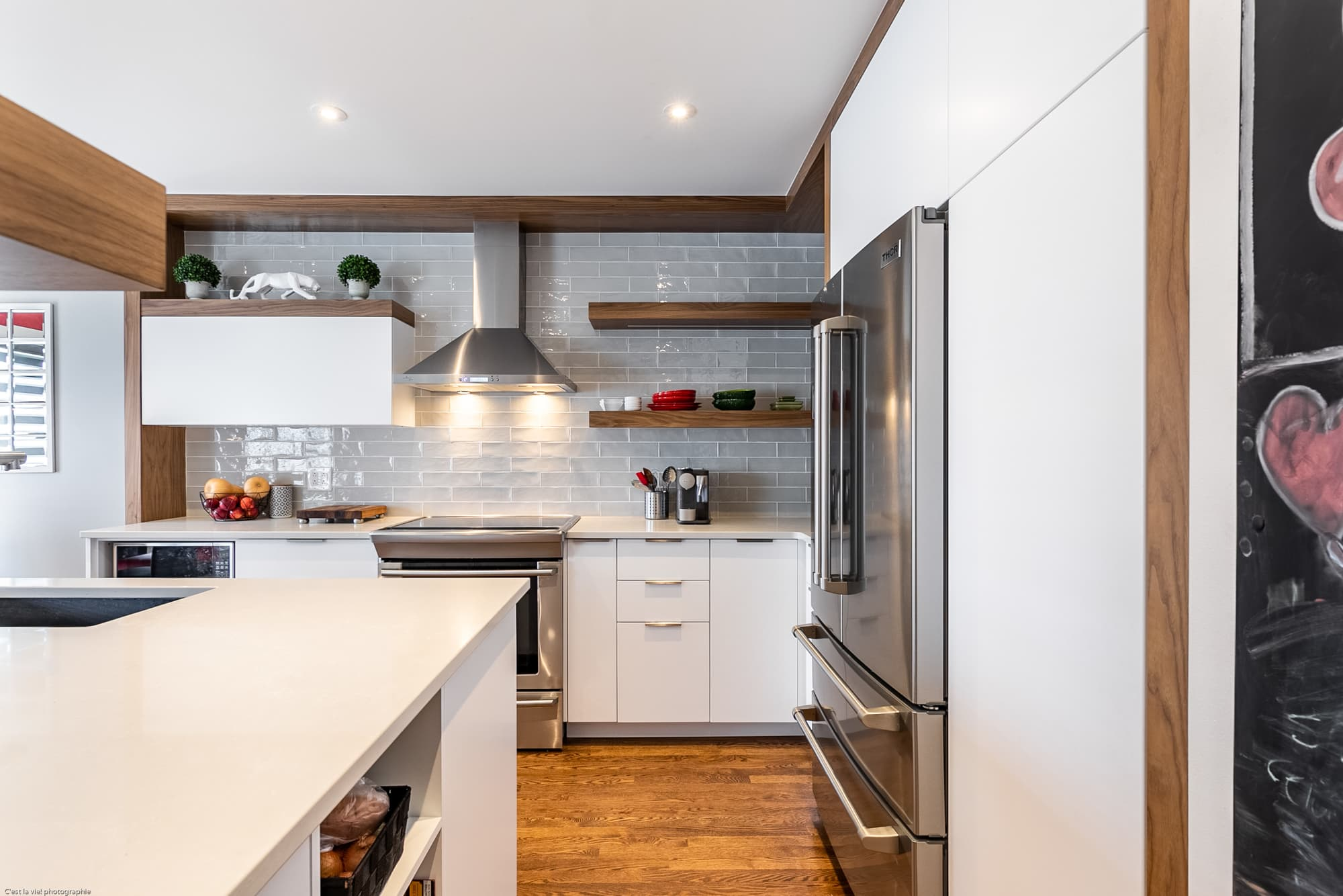 modern kitchen design with white cabinets and wooden open shelves
