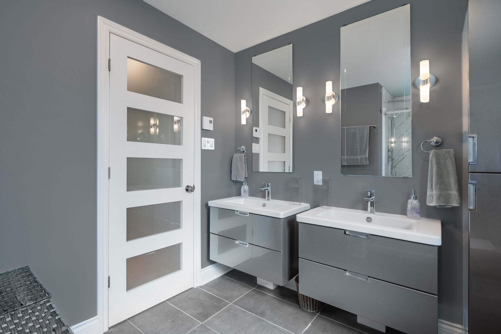 modern grey bathroom renovation with 2 suspended vanities