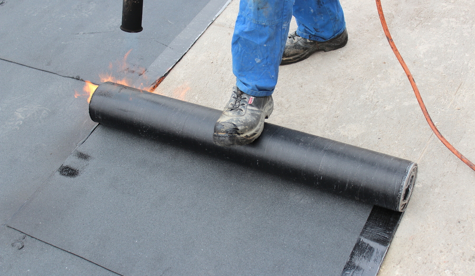 worker installing flat roof panels