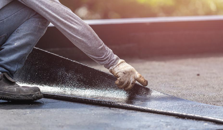 worker installing flat roof