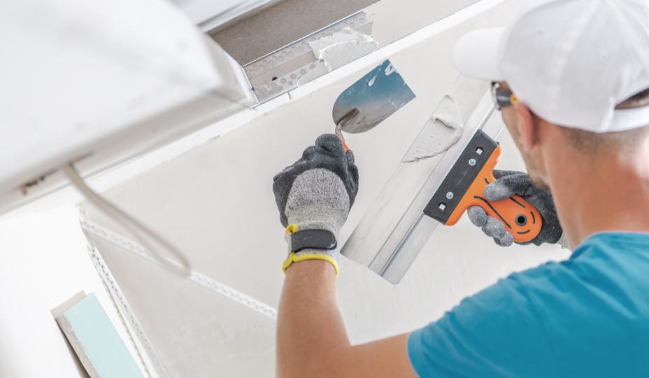man-installing-dywall