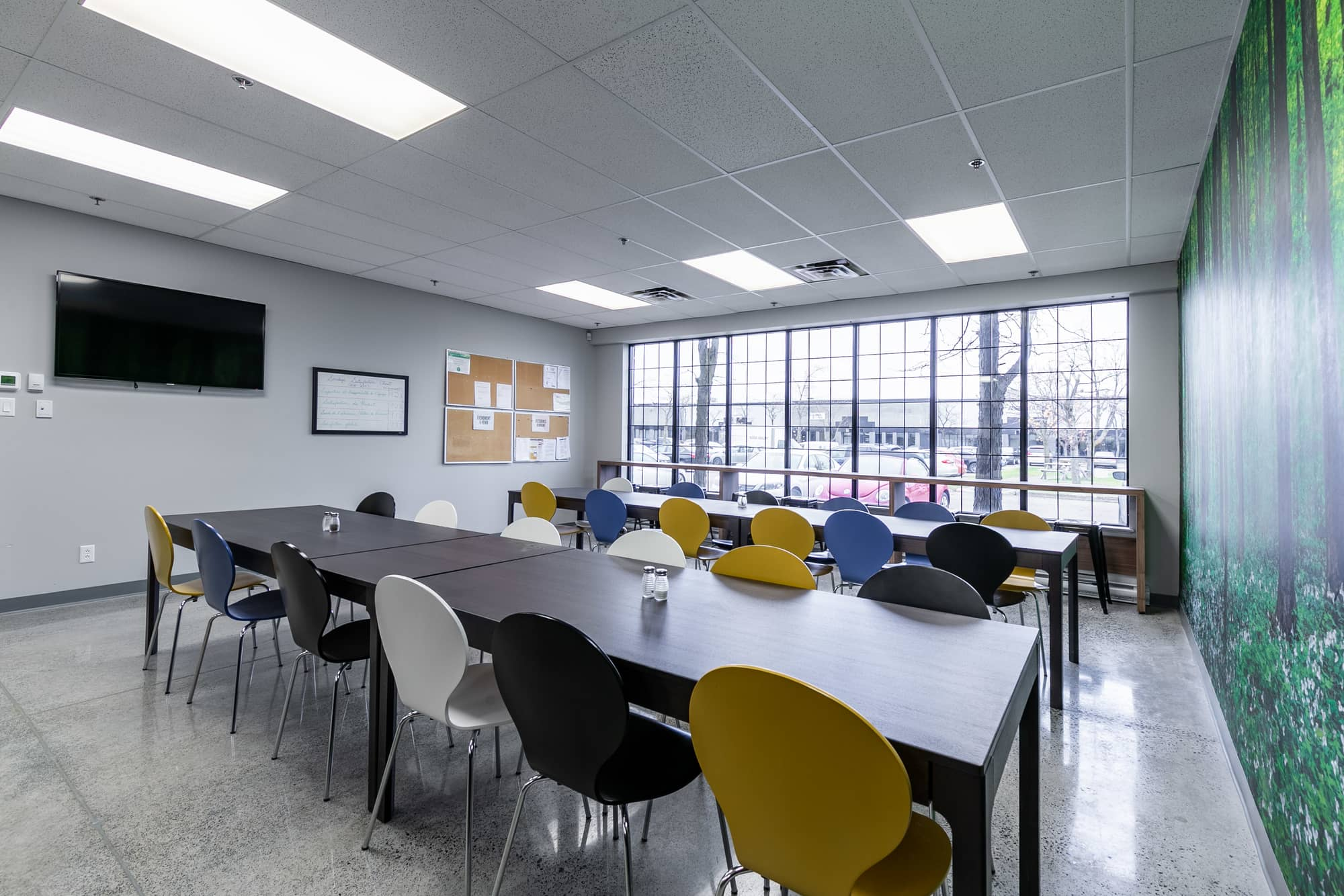 breakroom tables with colorful chairs and big windows