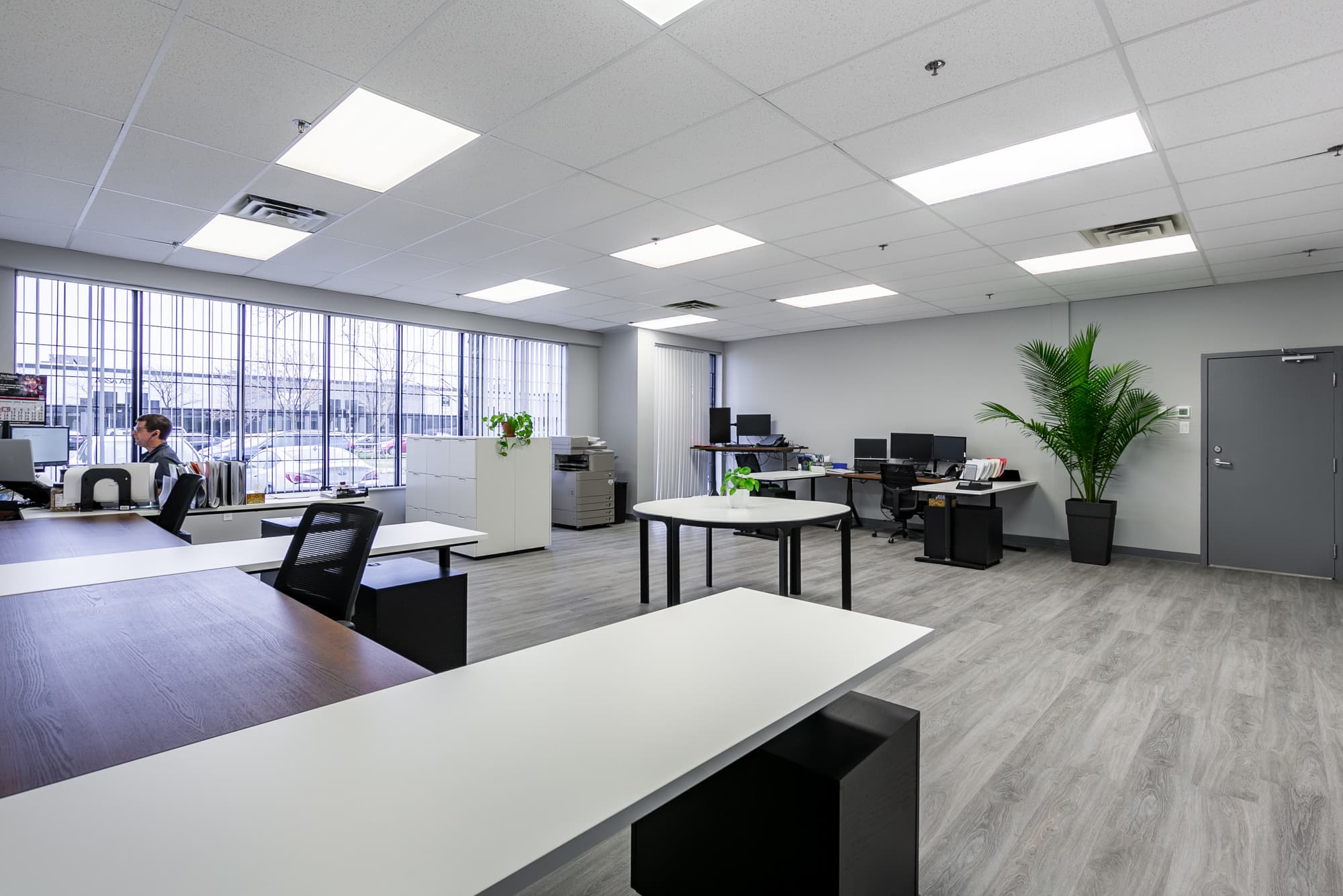 office space with tables and desks