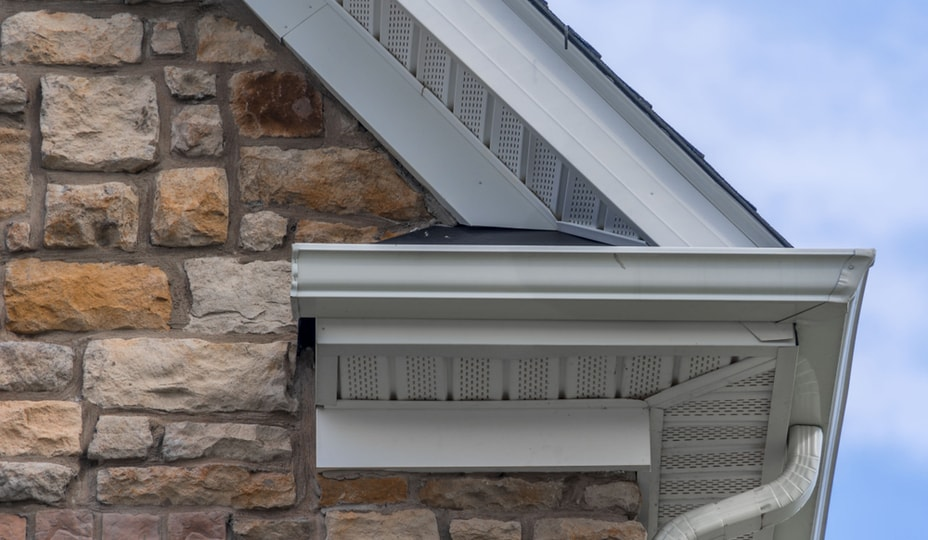 close up of eaves, soffits and downspouts of a roof