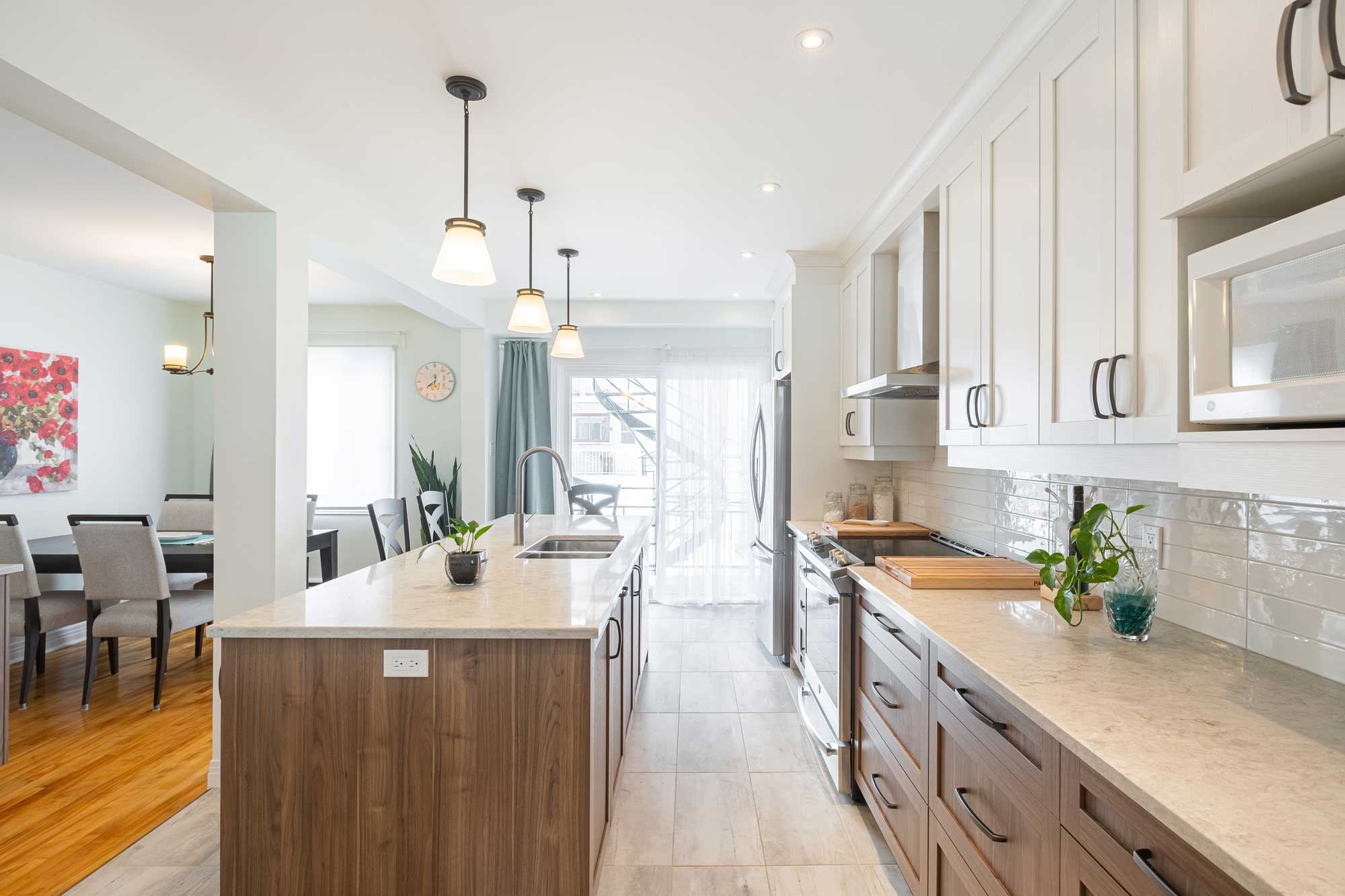 modern duplex kitchen with two toned cabinetry
