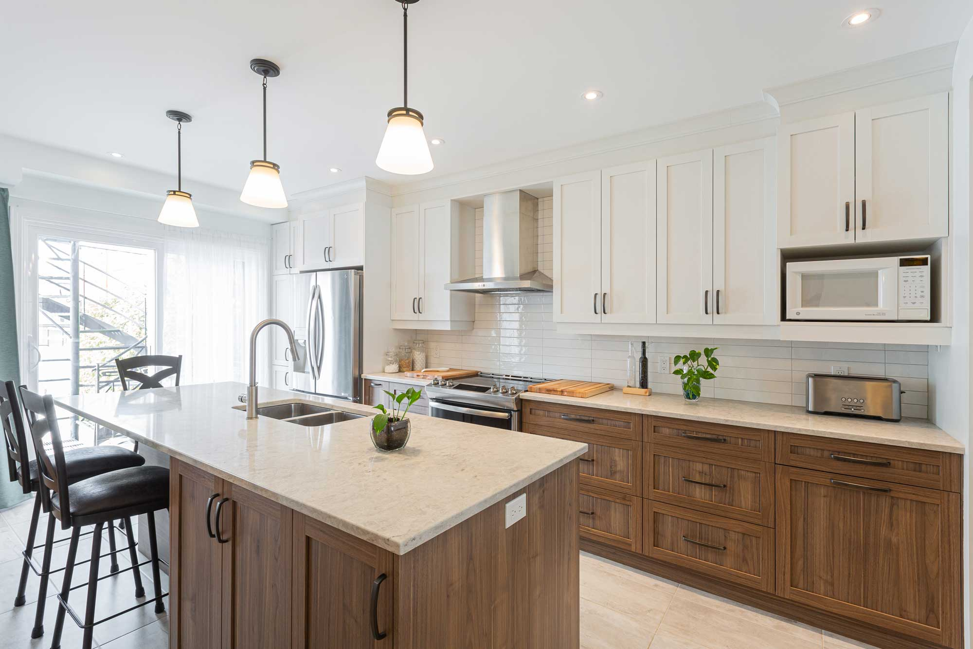 modern kitchen with white and wood custom cabinets