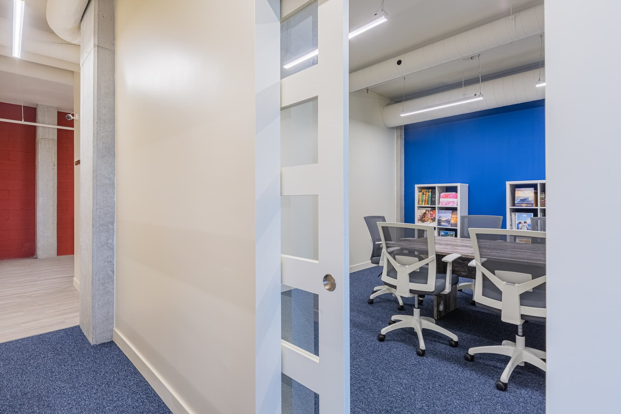 meeting space with blue carpet and accent wall