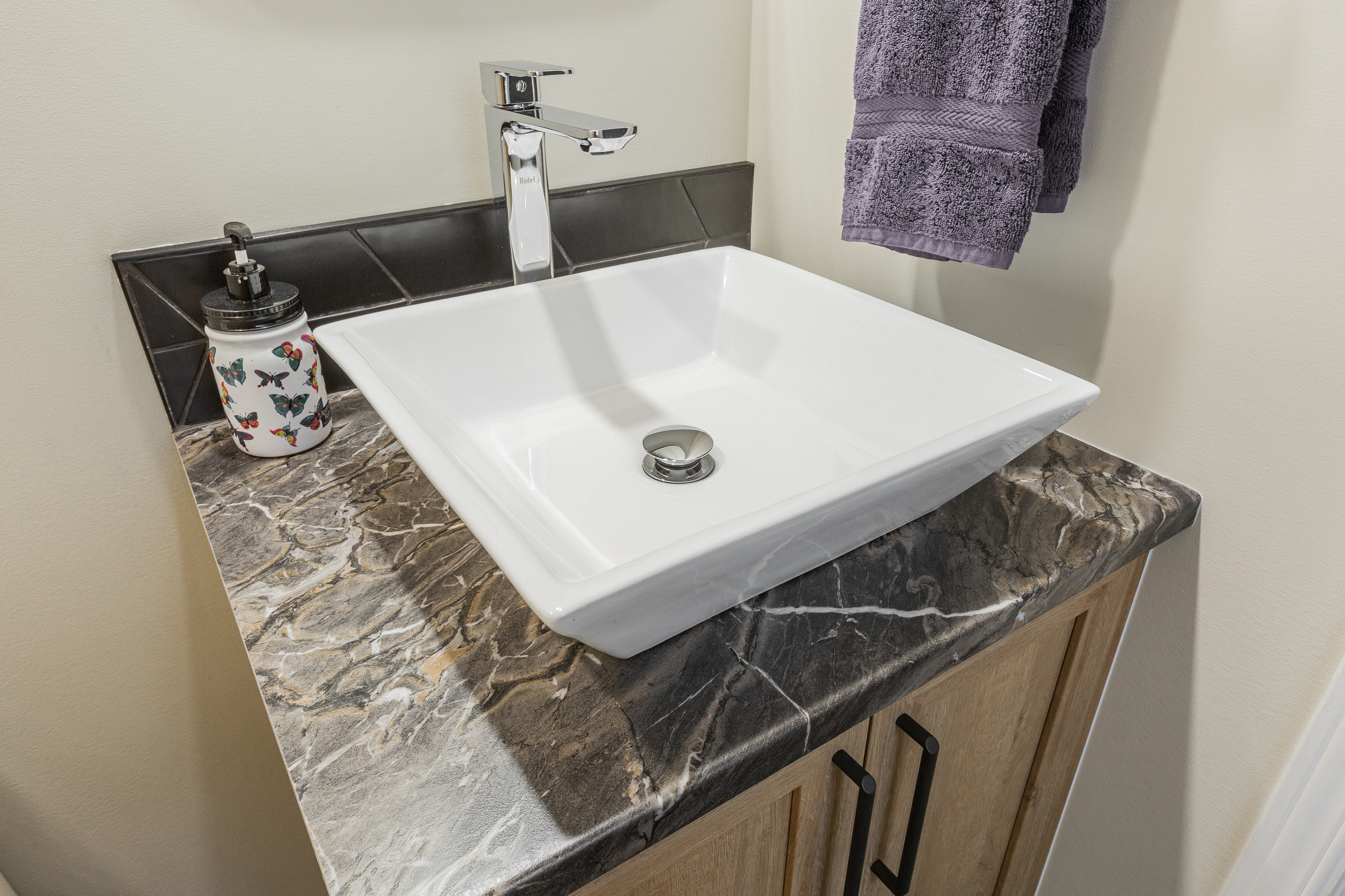 adorablevanity witharectangular basin and marble-effect laminate