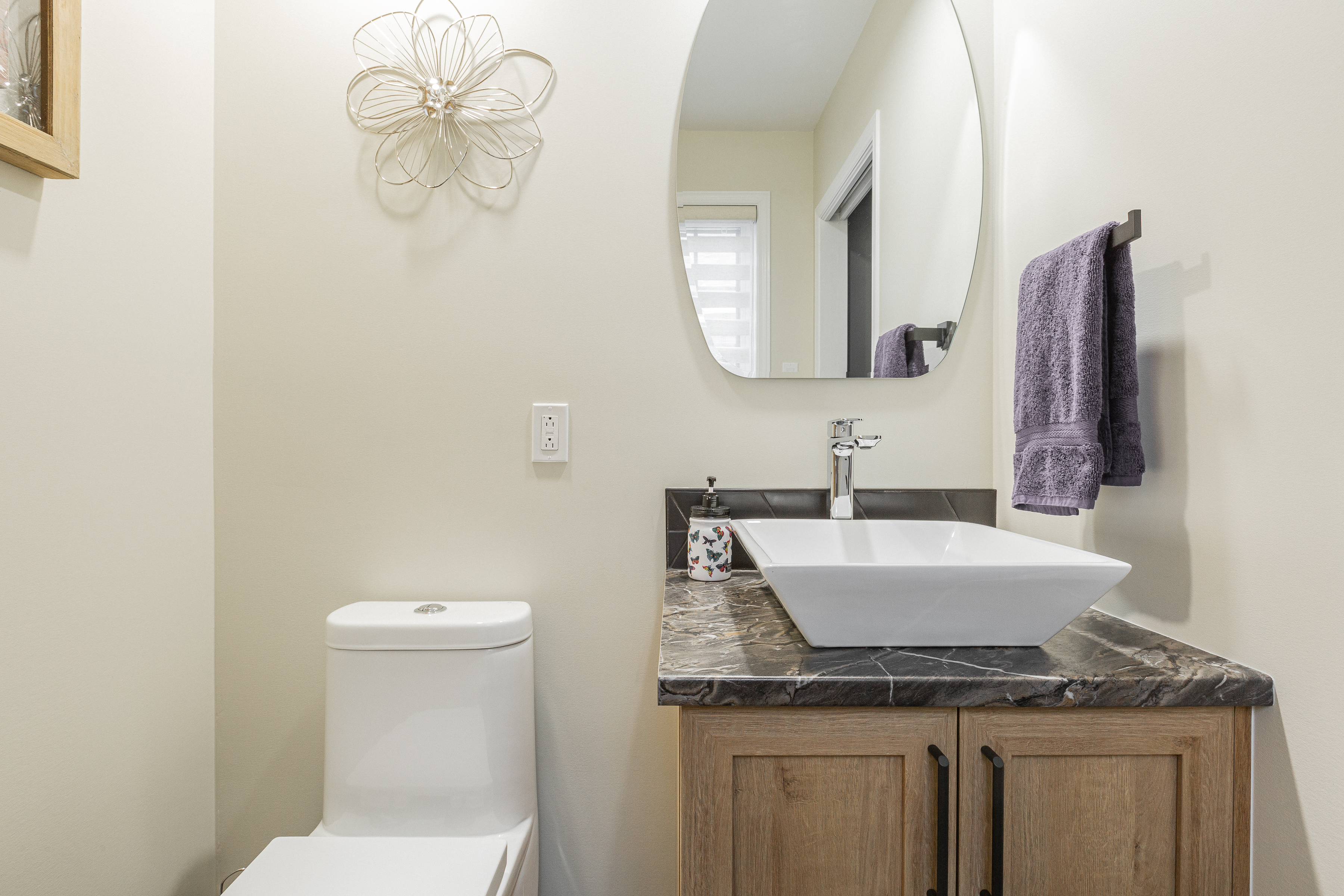 renovated powder room with a toilet and a wooden vanity