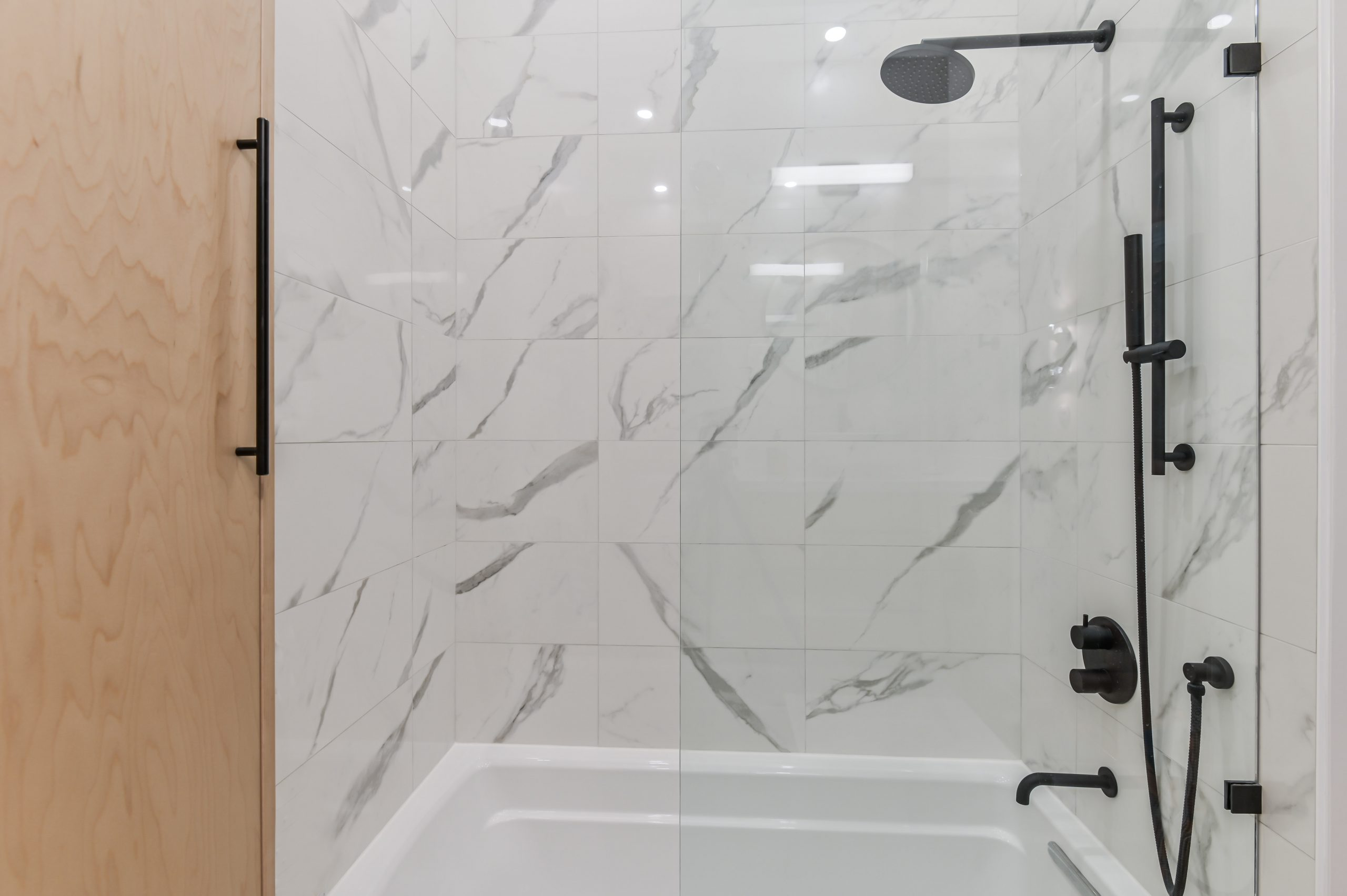 Nice spacious glass shower and its fency mat black accessories